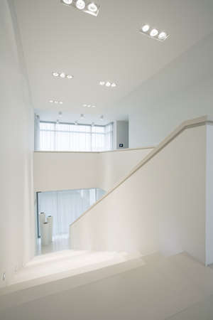 light interior: Pure, white stairway inside elegant interior, vertical