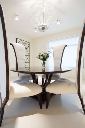 round chairs: Round table with chairs inside expensive residence Stock Photo