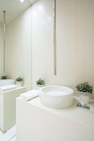 bathroom equipment: View of designed faucet inside white bathroom