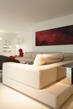 progressive art: View of beige sofa inside designed room