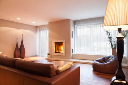progressive art: Interior of comfy living room with fireplace