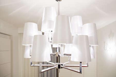 View of modern chandelier inside bright interior Imagens - 35522061