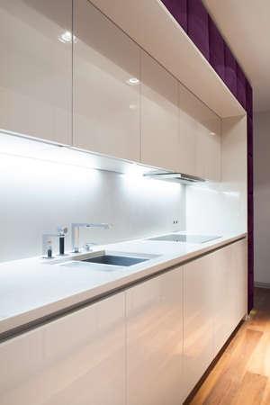 Interior of white and modern kitchen, vertical photo