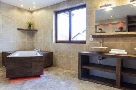 Interior of brown bathroom in modern house photo
