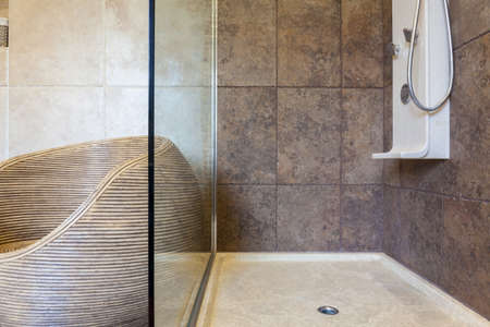 Porcelain shower base in a bathroom, horizontal photo