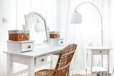 dressing table: White dressing table with wicker elements, horizontal Stock Photo