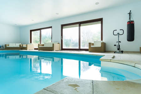 View of swimming pool inside expensive house Stock fotó