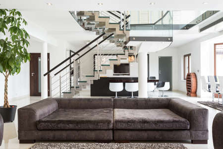 View of designed sofa in expensive house 스톡 콘텐츠
