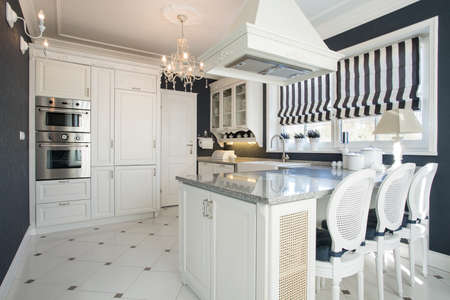 Beauty modern kitchen interior with white furniture 스톡 콘텐츠