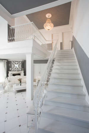 crystal chandelier: Beauty white stairs in elegant modern home Stock Photo
