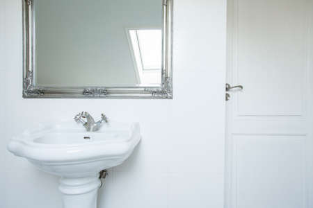 handbasin: Washbasin and mirror in clean white toilet