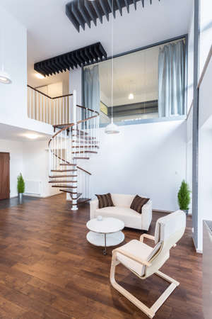 Fancy curly stairs in new elegant apartment 스톡 콘텐츠