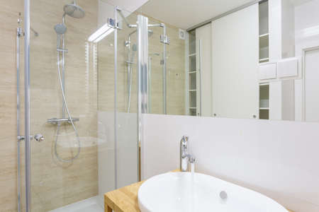 glass doors: Contemporary shower with glass door in new washroom Stock Photo