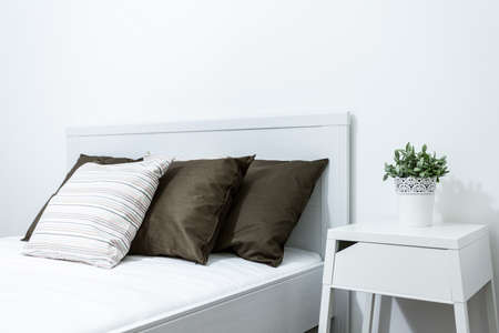 Close-up of comfortable bed in modern bedroom photo