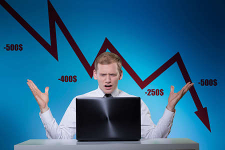 banker: Young banker losing money because of market crisis Stock Photo