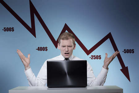 low prices: Young man frustrated of stock market crisis Stock Photo
