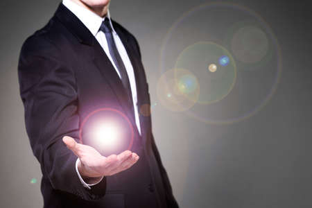 Image of businessman having power in hand