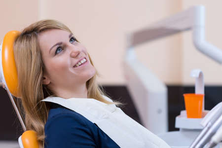 dental office: Portrait of girl sitting on the dental chair Stock Photo