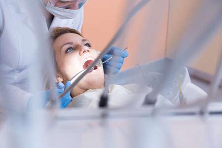Horizontal view of dentistry examining patients teeth photo