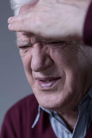 Portrait of suffering man having sinus pain photo