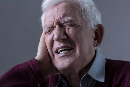 seniors suffering painful illness: Elder man having pain in the ear