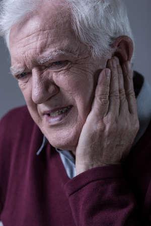 seniors suffering painful illness: Portrait of senior man having terrible toothache