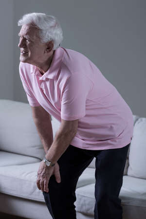 Senior man suffering for osteoarthritis of the knee