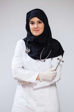 View of muslim doctor with reflex hammer photo