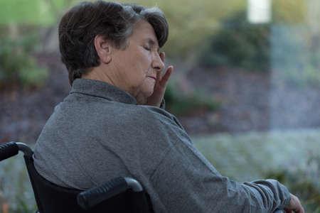 Elderly worried lady in nursing home