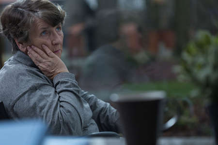 sorrowful: Aged sorrowful woman thinking about old times
