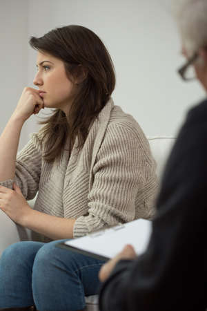 counseling session: Photo of unhappy young woman on therapy