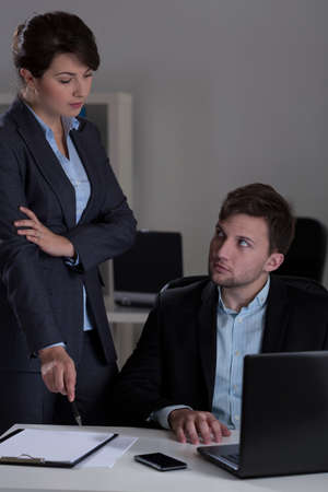 strict: Strict female manager talking with his employee