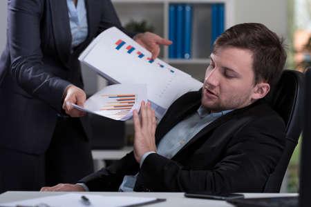 Horizontal view of overworked employee refusing work photo