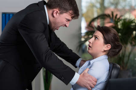 violence in the workplace: Mobbing in the workplace - boss yelling at employee