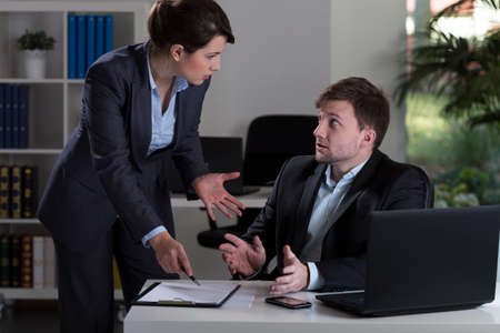 woman boss: Horizontal view of boss yelling at employee