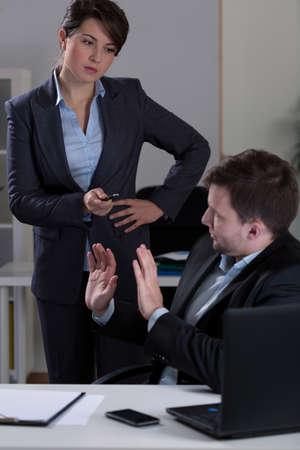 mobbing: Man being victim of mobbing in corporation