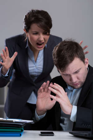 woman boss: Chief yelling at his assistant in corporation