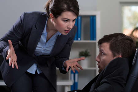 woman boss: Horizontal view of victim of workplace bullying