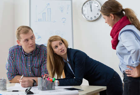 Workers at office having argument at workplace Stock Photo
