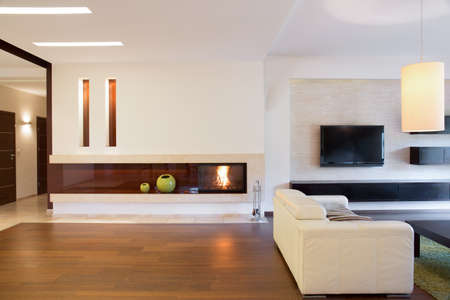 View of open living room with a fireplace Stock Photo