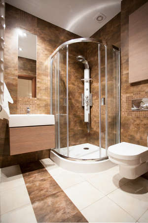 bathroom equipment: Vertical view of bathroom with a shower