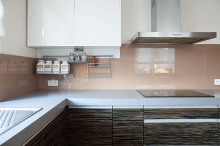 hob: Horizontal view of kitchen with induction hob Stock Photo