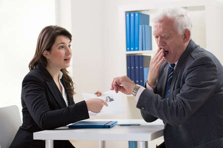 first: Young woman applying for a job and her bored interviewer Stock Photo