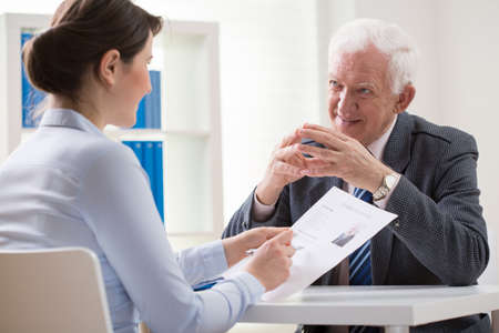 answering: Elder man answering the questions on job interview Stock Photo