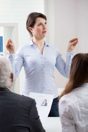 first job: Young womans ridiculous behavior on job interview Stock Photo