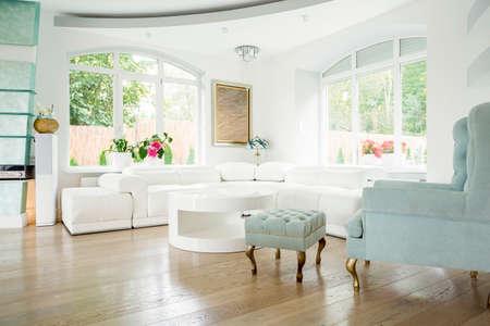 Designer armchair in luxury living room interior Foto de archivo