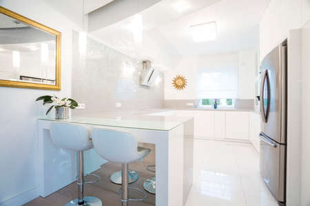 kitchen countertops: Horizontal view of designer white kitchen interior Stock Photo