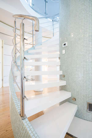 Designed stairs in shining interior in luxury mansion photo