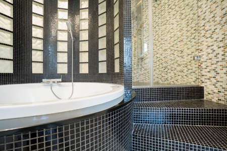 gleaming: Close-up of designed shower in gleaming bathroom