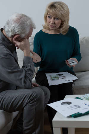 financial problems: Senior couple discussing about financial problems